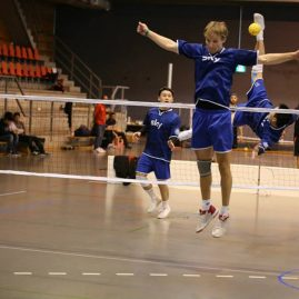 Christian of Elmshorn (2) attempts to block the spike of clubmate Trung of Elmshorn (1) in the semi-final
